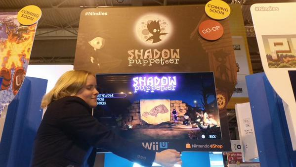 Developer Catharina Bøhler hugging Nindie stand for Shadow PUppeteer at EGX