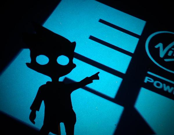 Shadow from Shadow Puppeteer pointing at EGX logo